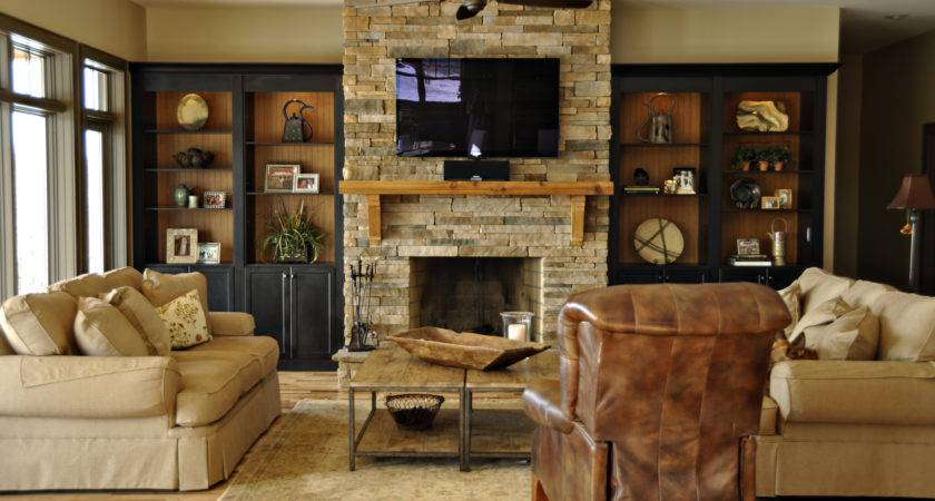 Bookcases Around Stone Fireplace