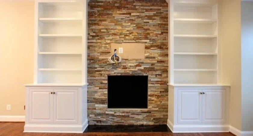 Custom Handcrafted Bookcases Encase Stone Fireplace