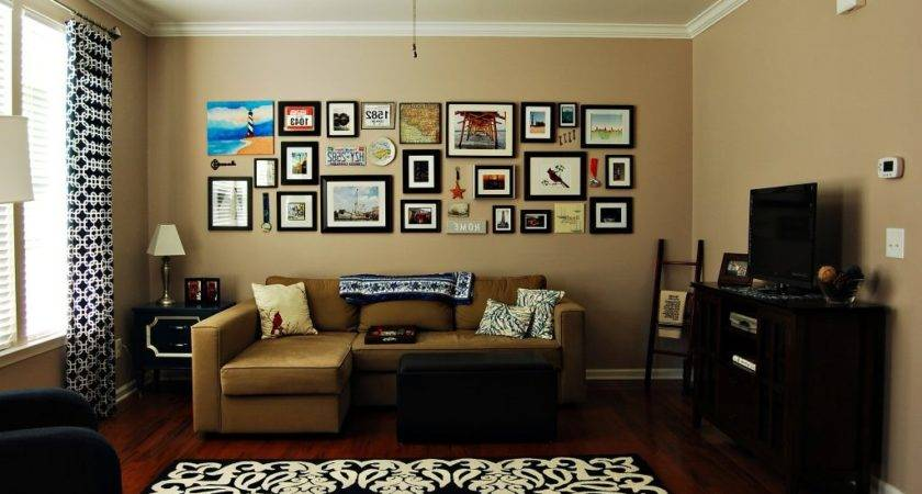 Tan Living Room Red Accents White Rug Wall