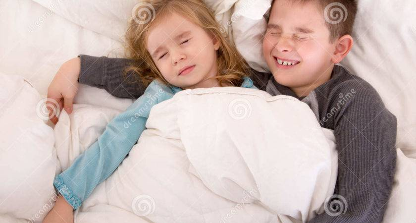 Two Cute Young Children Sleeping Bed