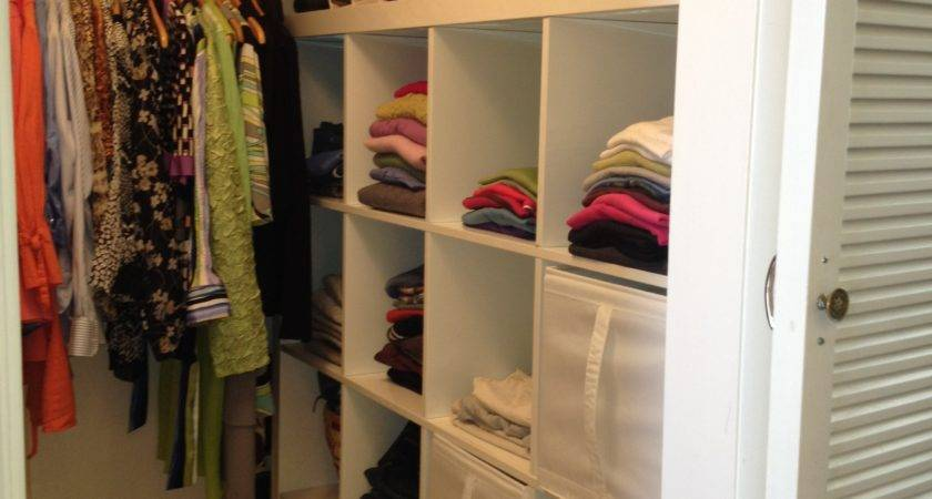 White Wooden Closet Space Hanging Clothes